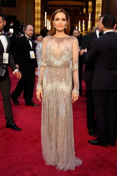 Jolie's Oscars 2014 dress was beyond breathtaking. The sheer, nude Elie Saab Couture gown draped beautifully, and her loose locks fell effor...