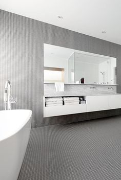 Pure white fixtures and grey mosaic tiles add a soothing touch to this award-winning bathroom. Bathroom Inspiration, Interior Design Inspiration, Design Ideas, Bathroom Ideas, La Shed Architecture, Grey Mosaic Tiles, 1920s House, Large Bathrooms, Minimalist Bathroom