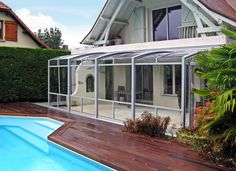 Silver frames used on terrace enclosure CORSO with pool nearby