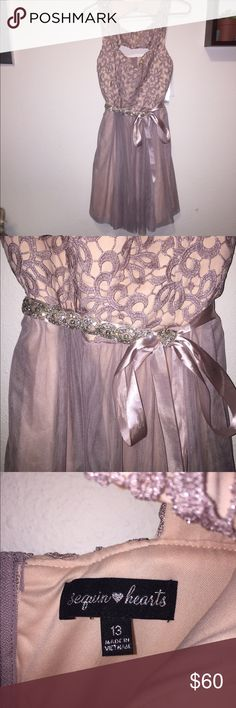 Prom Dress Gorgeous pink/purple dress from Macy's. Has a cut out in front and a sequined tie around the waist. Cut out in back with two pink buttons. Never warn! Perfect for and dance or event (: Macy's Dresses Prom
