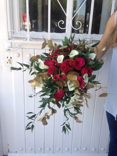 Make a statement with these Roseberry roses, Gloriosa lilies and Crystal Blush calla lilies mixed up with golden sprayed trailing foliage.