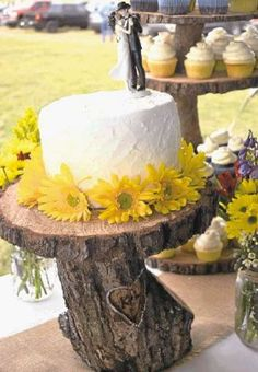 Logs are used to make a woodsy, DIY cake stand. / @WireImgId=2621715