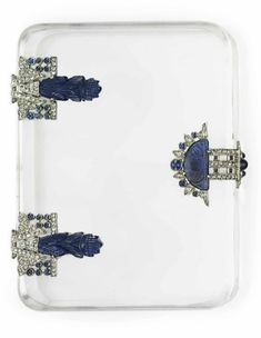 ART DECO DIAMOND AND MULTI-GEM CASES A hinged rock crystal case, with carved sapphire, cabochon sapphire and rose-cut diamond plaque detail, mounted in platinum, circa 1925, 3 1/2 x 2 5/8 x 3/4 ins., signed Bourdier, Paris