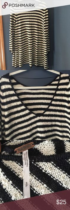 Free People black and white sweater dress Loose. Size small. Amazing condition only worn ONCE! Long sleeved. Lower scoop back. Free People Sweaters Crew & Scoop Necks