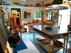 """Better work habits go hand-in-hand with a functioning workspace,"""" says Lori McNee. """"Years ago, I converted a small bedroom of my home into an efficient art studio. To help minimize clutter, I added high shelves which display my still life props and art studies. Big French doors replaced a small window which now adds to extra studio space during the summer months Recently, I painted the dingy plywood floors for a fresh look and easier clean-up."""""""