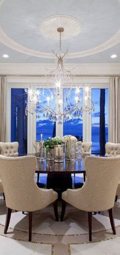 Lovely dining room, the chandler is just stunning, it looks the room was built around and for it.