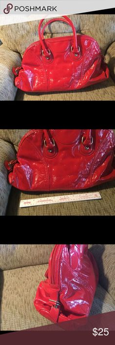 """Cute Large Red Purse Cute Large Red Purse  Approximately 11-12"""" height x 19""""width  Zipper closure outside straps to adjustable height of purse. The inside one zipper pocket and two cute pouches with Phrase! One says """"My life is my bag..."""" other says """"Chat with me!""""  Like Brand New!                               ♡GOD BLESS♡                    ☆BUNDLE AND SAVE 5%☆              ♡ASK I WILL REPLY PROMPTLY♡       ☆SHARE & FOLLOW I WILL DO THE SAME☆    ☆REASONABLE OFFER'S ALWAYS WELCOMED☆ Nine…"""