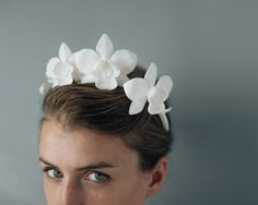 A clean, utterly modern, and super-stylish take on the flower crown, our orchid headpiece is an absolute showstopper. 3D printed from smooth matte nylon, its a refreshingly organic take on a high-tech process. Three orchids and a spray of buds arch elegantly over the head- this can be styled a variety of ways, but we love it as a Frida-Kahlo-esque headband! A 3/8 white petersham grosgrain ribbon is attached to the edges of the crown for versatility- for a seamless look, the ribbons can…