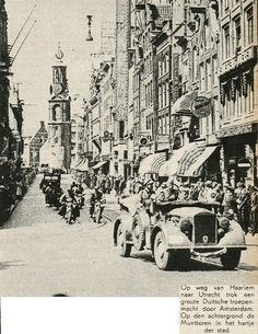May 1940. German troops after capitulation on the Reguliersbree Straat in the center of Amsterdam on their way to Utrecht. In the background the Munt Toren. #amsterdam #worldwar2