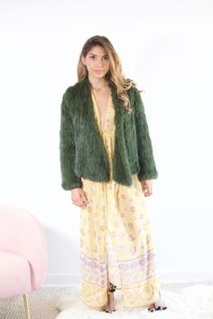 The 'Koyto' moss green fur jacket is an essential luxe layering piece for every woman's wardrobe. This baby is an Autumn must have.  For the gal that loves to wear something a little different this colour not only looks ultra stylish over your every day staples but could be the finishing touch to that soft patterned print you love.