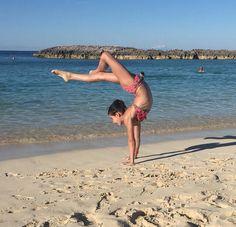 Annie the Gymnast! Instagram @presshandstands #GymnasticOnTheBeach