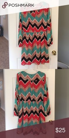 Women's chevron dress Size Large. Long sleeve. Sleeves are  lightweight. Very pretty dress with a belt. Colors: real, black, white, coral, tan. My Michelle  Dresses Midi