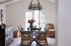 """This is the family table,"" says Kendall. ""We have dinner, the girls do their homework."" It was reimagined from an antique Spanish door. The rattan chairs add airy space. A vase by potter Miri Mara sits near striped cups by a local artisan. Kendall, The Kitchen Show, Set Of Drawers, Mediterranean Style Homes, Design Blog, Design Art, California Style, California Fashion, Love Home"