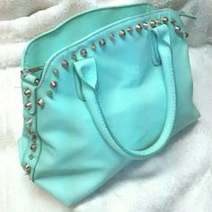 """Aqua Turquoise Handbag with Studs and pockets 11.5"""" wide/ 9.5"""" tall/ 6"""" deep at bottom. The amount of zippers and pockets on this bag is crazy. It is so easy to organize your stuff in a bag like this. One external zipper pocket (for your phone maybe). Super cute colorful leather. You'll love it!! It's missing the longer strap, but otherwise in perfect condition. Blue with green tones. Rebecca Minkoff Bags Totes"""