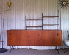 Retro Vintage Danish Style Teak Sideboard with custom multi tiered shelving & hairpin legs designed by Kurrlson Ind. https://www.facebook.com/hairpinlegs