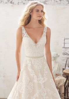 Wedding Dresses and Bridal Gowns by Morilee designed by Madeline Gardner. This Classic A-Line Lace and Tulle Wedding Gown Features a Crystal Beaded Trim.