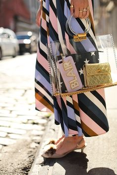 Blair Eadie carrying a clear tote bag with her signature iphone case and mini Chanel bag // Click to see more of this bag and her under $100 striped dress on Atlantic-Pacific