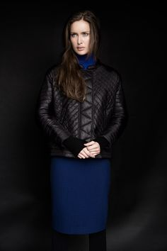 290453c1e58 Black padded jacket paired with blue fitted skirt