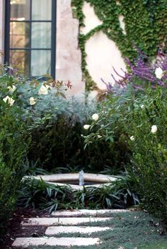 reflecting pool/small fountain surrounded by perennials