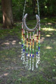Excited to share this item from my etsy shop horseshoe sun catcher rainbow sun catcher garden art yard decor Horseshoe Projects, Horseshoe Crafts, Horseshoe Art, Beaded Horseshoe, Horseshoe Ideas, Horseshoe Wreath, Carillons Diy, Décoration Harry Potter, Art Perle