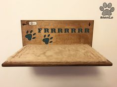Wooden catshelf with carved name