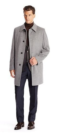 This classic coat by BOSS is made of a virgin wool and cashmere blend. Corduroy lines the underside of the turn-down collar, which includes a removable strap. The front includes four buttons along the placket and two slash pockets. Waist darts add structure. Three-button cuffs and a back vent complete the look.