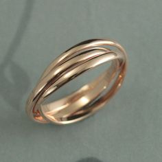 This is an absolutely stunning ring! Hand made from three solid 14K gold 2mm wide half round bands that are interlocked together, it is custom made to