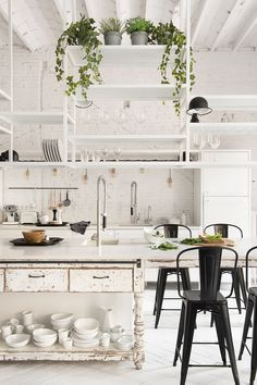 Is This the Next Big Kitchen Trend? via @MyDomaine open shelves hanging from ceiling, dining island