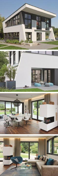 Modernes Design Haus mit Pultdach Architektur & Wohnzimmer mit Kamin - Einfamilienhaus bauen als Skulpturales Architektenhaus von WeberHaus - HausbauDirekt.de