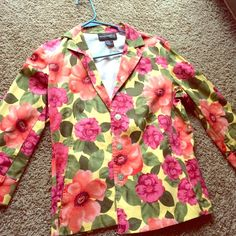 Floral blazer Very cute, vintage floral blazer. No tags but I've never worn it. I just couldn't pull it off. It's a size 10P and can fit either a small or a medium. The flowers are a fuchsia/pink color and orange/coral with green leaves all around. Jackets & Coats Blazers