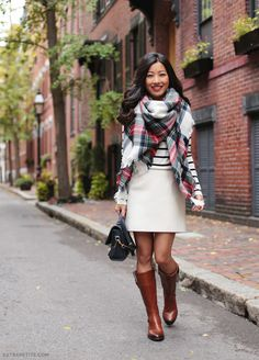 Classic Fall casual outfit: wool skirt, striped tee, plaid blanket scarf, leather brown riding boots
