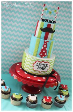 Little Man themed baby shower cake with matching cupcakes. Chevron bottom tier made with wafer paper
