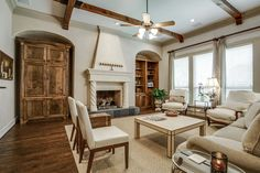 Soft and sophisticated living room- love the fireplace and the studded coffee table