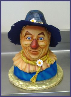 This Wonderful Wizard of Oz Cake was made by Arshawsky's Cake Ops Custom and Edible Art. I like the way the eyes and facial expression capture the personality of the Scarecrow from the Wizard of Oz. The craftsmanship of this cake is incredible. Where in the heck is the love button....the work here is right on... Good job