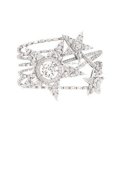 The Etoile Filante bracelet is a reinterpretaion of the Comète necklace. The shooting star was a popular inspiration for Coco Chanel. Set in 18K white gold set with a three-carat round-cut diamond, 99 baguette-cut diamonds, 36 fancy-cut diamonds, 154 brilliant-cut diamonds, 26 princess-cut diamonds, and three triangle-cut diamonds.   - ELLE.com