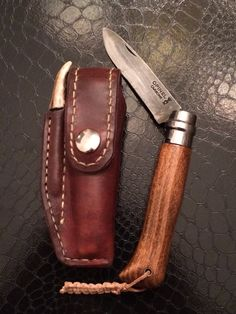 Leather sheath and mods to my Opinel knife. Forced patina on the blade and reshaped handle.