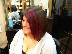 Asymmetrical bob with Hot Pink Highlights By Erin @Cappella's Studio