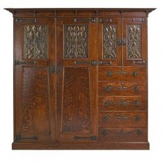 Again--freaking gorgeous wood, but I like the way the vertical stiles get thicker going up, the leaded glass. ENGLISH ARTS & CRAFTS Wardrobe