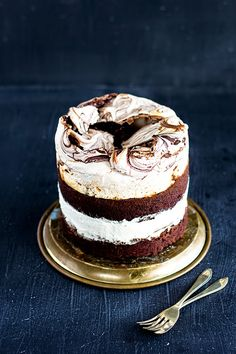 mbakes: Chocolate Meringue Cake - chocolate cake, whipped cream, pomegranate seeds and chocolate swirled meringue.