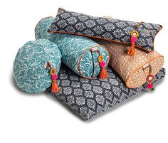 Yoga bolsters and meditation cushions in lovely shades of orange, grey and blue.  Finished with illuminating orange detail and colorful mirror tassels like those seen on the camels of Rajasthan's great Thar Desert. Plus zafu and zabuton in Black Marigold, meditative neck cushions and Savasana blankents. Beautiful in any home practice or studio interior.