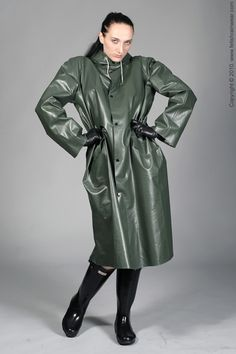 Latex Kitty wearing a stunning vintage black shiny trench coat, a cute rain hat, black rubber boots and latex gloves.