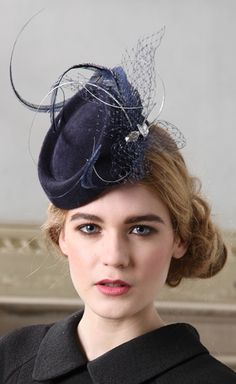 Jane Taylor Millinery, Leticia, A/W 2013 - Velour felt pillbox hat with ostrich feathers, veiling, quill  Swarovski crystal detail.