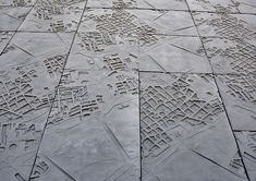 maps of ancient walled cities printed onto concrete facade. Nieto Sobejano - Merida auditorium and conference center. construction process http://www.d-y-d.com/sv/svcm/indexcm.html