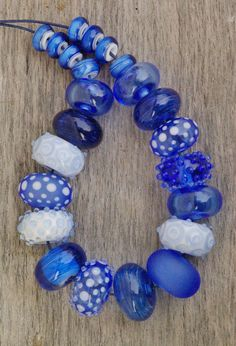 Lampwork glass bead set, blue and white, dots. https://www.etsy.com/shop/LailaStrazdina