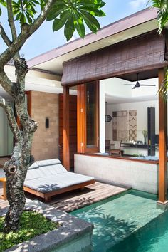 What We Love: living room windows that can be folded away, converting the space into an elegant pool pavilion. The Elysian Boutique Villa Hotel (Bali, Indonesia) - Jetsetter