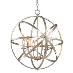 Orbiting metal bands circle the contemporary inner chandelier, allowing light to gently cascade through the openings. This family is made up of round and oval shapes finished in brushed nickel and complemented with matte opal glass.