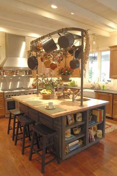 Pot rack over kitchen island.                                                                                                                                                     More