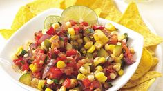In addition to tomatoes, this salsa features corn, zucchini and red bell pepper. Olè!