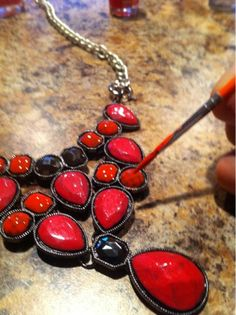 "Make over a statement necklace with nail polish. Brilliant for those ""not quite what I was looking for"" thrift store pieces :)"