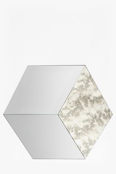 Hexagonal segment mirror Glass mirror with antique effect Please note: this item has been designed with an intentionally different colour and finish to each section of the mirror Height: 102cm Width: 89cm Depth: 2cm